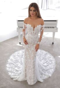 Naroza by Blue by Enzoani 2021 collection off the shoulder long sleeves Hailey Beiber wedding dress at Love it at Stella's in Westminster, MD
