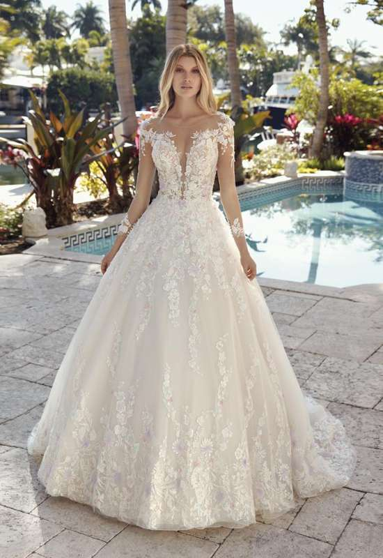 Demetrios long sleeve textured 3D flowers ballgown wedding dress with long sleeves at Love it at Stella's Bridal in Westminster, MD bridal shop in greater baltimore area