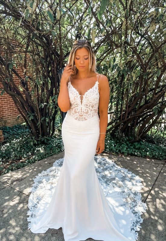 Crepe lace dress with spaghetti straps and removable off the shoulder straps and long train at Love it at Stella's Bridal in Westminster, MD