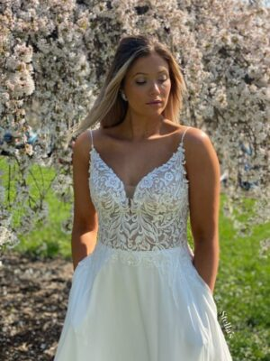 a-line sheer sparkly bodice spaghetti strap flowy lace and chiffon wedding dress at Love it at Stellas Bridal and Fashions in Westminster Md