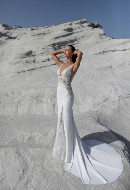 Olente by Le Papillon by Modeca sexy lace and crepe wedding dress with deep v and leg slit at Love it at Stella's Bridal shop in Westminster, Maryland