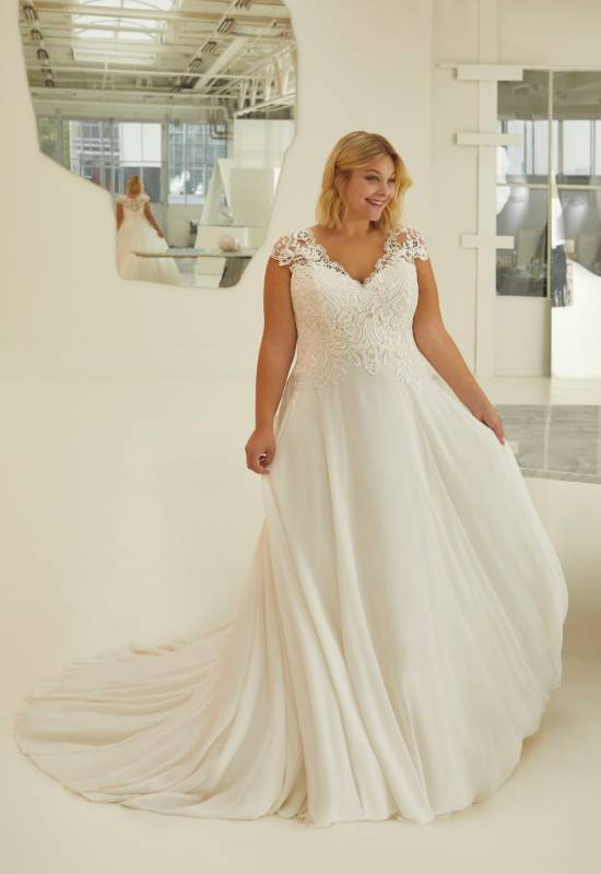 Plus size wedding dress with lace cap sleeves and chiffon flowy skirt at Love it at Stella's in Westminster, Maryland