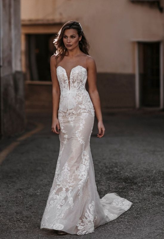 Mikaela by Abella Bride contemporary style wedding dress with illusion neckline and buttons with sparkle tulle and bow at Love it at Stella's Bridal Shop in Westminster, Maryland
